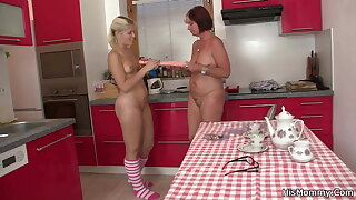 Lesbian blonde teen and mom toying superior to before kitchen