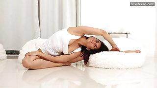 Busty brunette Alica Bruno is well-endowed flexible